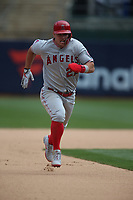 OAKLAND, CA - MARCH 28:  Mike Trout #27 of the Los Angeles Angels runs the bases against the Oakland Athletics during the game at the Oakland Coliseum on Thursday, March 28, 2019 in Oakland, California. (Photo by Brad Mangin)