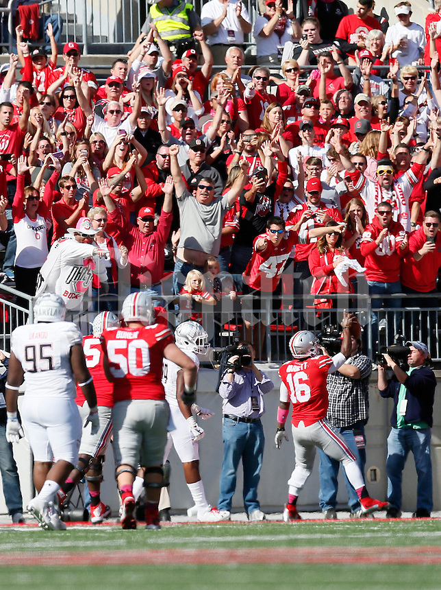 Ohio State Buckeyes fans erupt as Ohio State Buckeyes quarterback J.T. Barrett (16) rushes for a touchdown in the fourth quarter of the college football game between the Ohio State Buckeyes and the Maryland Terrapins at Ohio Stadium in Columbus, Saturday afternoon, October 10, 2015. The Ohio State Buckeyes defeated the Maryland Terrapins 49 - 28. (The Columbus Dispatch / Eamon Queeney)