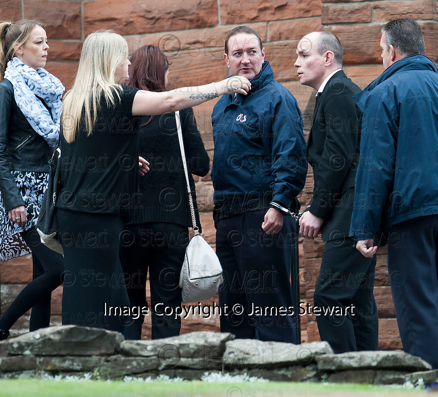 Hugh Haney, still handcuffed to a G4S officer, arrives for the funeral of former crime family matriarch Mags Haney at St Mary's RC Church in Stirling.
