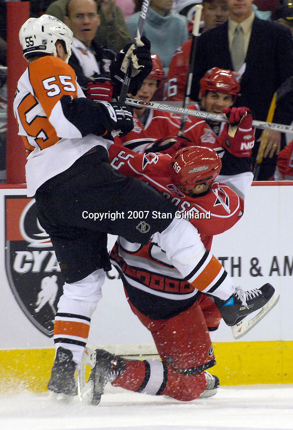 The Philadelphia Flyers' Ben Eager (55) brings down the Carolina Hurricanes' Chad LaRose during their game Wednesday, Nov. 21, 2007 in Raleigh, NC. The Flyers won 6-3.