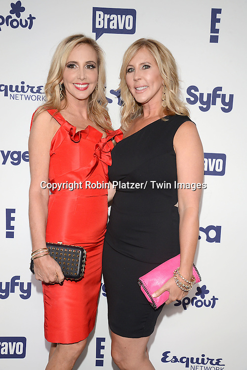 Shannon Beador and Vicki Gunvalson of The Real Housewives of OC attend the NBCUniversal Cable Entertainment Upfront <br /> on May 15, 2014 at The Javits Center North Hall in New York City, New York, USA.