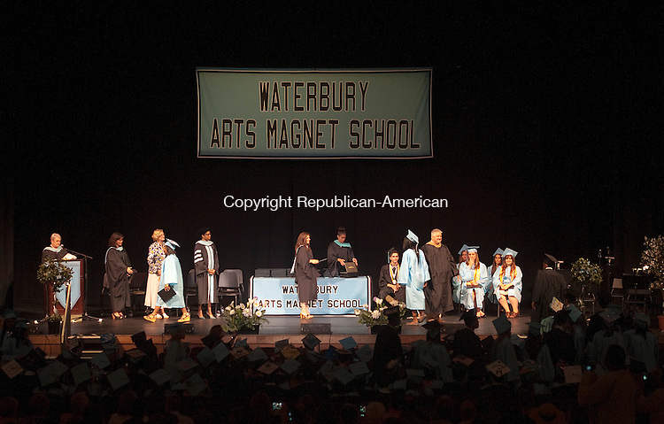 WATERBURY, CT-061714JS05--Students receive their diploma during Waterbury Arts Magnet School's graduation ceremonies Tuesday at the Palace Theater in Waterbury.<br />  Jim Shannon Republican-American
