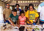 WATERBURY, CT. 13 July 2019-071319 - From left front, Donovan Degree, 8, MaKenzie Watkis, 6, and Kayla Ireland, 16, all of Waterbury makes their special ice cream sundaes during the NAACP's monthly meeting and Ice Cream social at Fulton Park in Waterbury on Saturday. Bill Shettle Republican-American