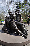 Tourists view this sculpture honoring the sacrifice and service of  women  during the Vietnam war. The sculpture is part of the National Vietnam  War Memorial, located in Washington DC in the US.