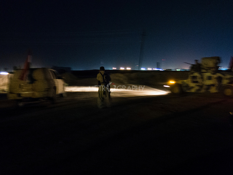 02/10/14  Iraq -- Daquq, Iraq -- Peshmerga humvees going to the front line at night in Wahda village, Daquq.