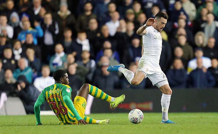 Leeds United's Jack Harrison vies for possession with West Bromwich Albion's Nathan Ferguson<br /> <br /> Photographer Rich Linley/CameraSport<br /> <br /> The EFL Sky Bet Championship - Tuesday 1st October 2019  - Leeds United v West Bromwich Albion - Elland Road - Leeds<br /> <br /> World Copyright © 2019 CameraSport. All rights reserved. 43 Linden Ave. Countesthorpe. Leicester. England. LE8 5PG - Tel: +44 (0) 116 277 4147 - admin@camerasport.com - www.camerasport.com