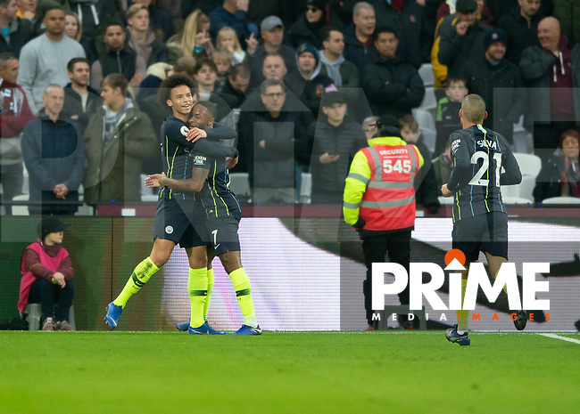 Raheem Sterling of Manchester City celebrates scoring with Leroy Sané of Manchester City during the Premier League match between West Ham United and Manchester City at the Olympic Park, London, England on 24 November 2018. Photo by Vince Mignott / PRiME Media Images.