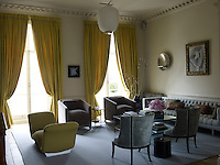 In the drawing room the custom-made silk curtains perfectly match the daybed by Pierre Paulin
