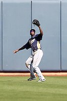 Cameron Maybin #24 of the San Diego Padres waits for a fly ball in a spring training game against the Seattle Mariners at Peoria Stadium on February 27, 2011  in Peoria, Arizona. .Photo by:  Bill Mitchell/Four Seam Images.