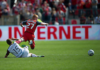 17 September 2011: Colorado Rapids midfielder Wells Thompson #15 slide tackles Toronto FC defender Richard Eckersley #27 from behind during an MLS game between the Colorado Rapids and the Toronto FC at BMO Field in Toronto, Ontario Canada..Toronto FC won 2-1.
