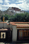A Temple in Lhasa, Tibet, the Potala palace is in the background