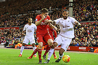Kyle Bartley competes with James Milner during the Barclays Premier League Match between Liverpool and Swansea City played at Anfield, Liverpool on 29th November 2015