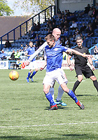Michael Doyle gets to the ball first in the SPFL Ladbrokes Championship Play Off semi final match between Queen of the South and Montrose at Palmerston Park, Dumfries on  11.5.19.
