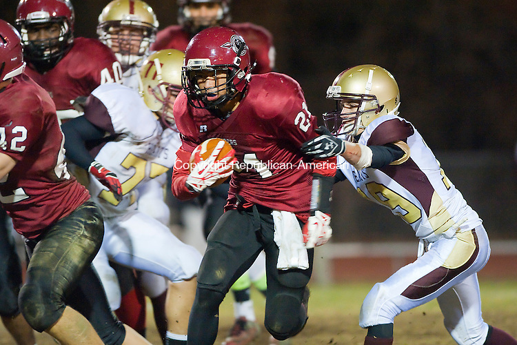 WATERTOWN- 111513JS01- Torrington's Dominick Phengkaen (21) slips past Sacred Hearts' Carmen Perugini (19) for a 42 yard touchdown run during their game Friday at Torrington High School.<br /> Jim Shannon Republican-American