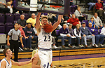 SIOUX FALLS, SD - NOVEMBER 25: Drew Guebert #23 from the University of Sioux Falls slams home two points against Southwest Minnesota State University during their game Saturday night at the Stewart Center in Sioux Falls. (Photo by Dave Eggen/Inertia)