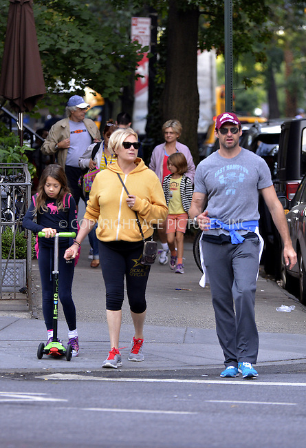 WWW.ACEPIXS.COM<br /> <br /> October 3 2013, New York City<br /> <br /> Actor Hugh Jackman and his wife Deborra-Lee Furness take their daughter Ava to school on October 3 2013 in New York City<br /> <br /> By Line: Curtis Means/ACE Pictures<br /> <br /> <br /> ACE Pictures, Inc.<br /> tel: 646 769 0430<br /> Email: info@acepixs.com<br /> www.acepixs.com