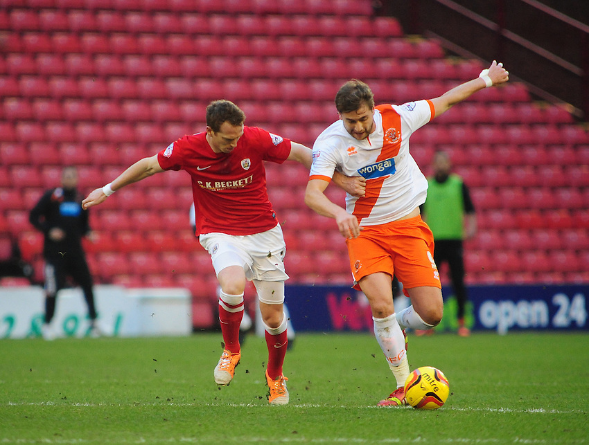 Barnsley's Peter Ramage vies for possession with Blackpool's Steven Davies <br /> <br /> Photo by Chris Vaughan/CameraSport<br /> <br /> Football - The Football League Sky Bet Championship - Barnsley v Blackpool - Saturday 18th January 2014 - Oakwell Stadium - Barnsley<br /> <br /> &copy; CameraSport - 43 Linden Ave. Countesthorpe. Leicester. England. LE8 5PG - Tel: +44 (0) 116 277 4147 - admin@camerasport.com - www.camerasport.com