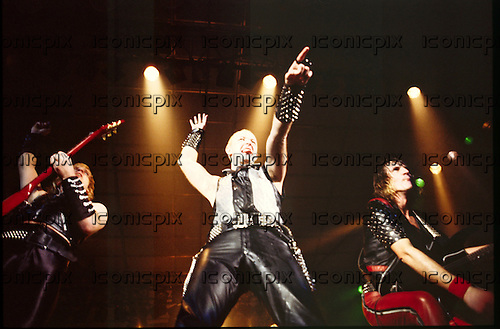 Judas Priest - L-R: KK Downing, Rob Halford, Glenn Tipton - performing live the Metal Conqueror Tour at the Jaap Edenhall in Amsterdam Netherlands - 27 Jan 1984.  Photo credit: IconicPix