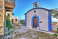 A small church in a picturesque alley at the old Chora of Alonissos island, Greece