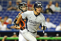 7 March 2012:  FIU utility player Oscar Aguirre (8) runs to first base as the Miami Marlins defeated the FIU Golden Panthers, 5-1, at Marlins Park in Miami, Florida.