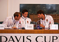 30-01-2014,Czech Republic, Ostrava, Cez Arena, Davis Cup, Czech Republic vs Netherlands, draw, city hall, l.t.r.Thiemo de Bakker (NED), Igor Sijsling (NED) and Robin Haase (NED) looking at the program book.<br /> Photo: Henk Koster