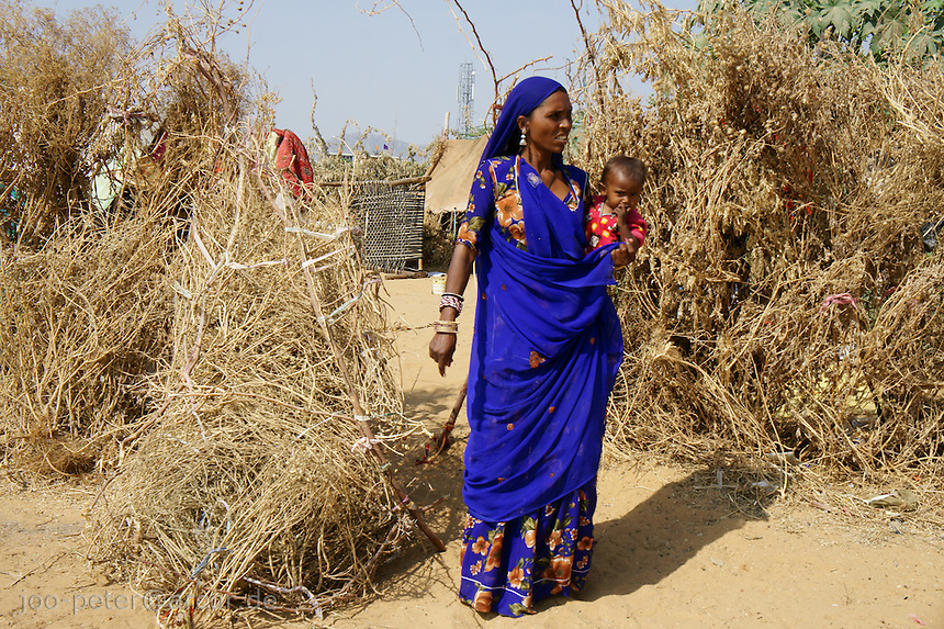 Babhu Dewi outside her family home tent compound near city Pushkar, Rajastan, India