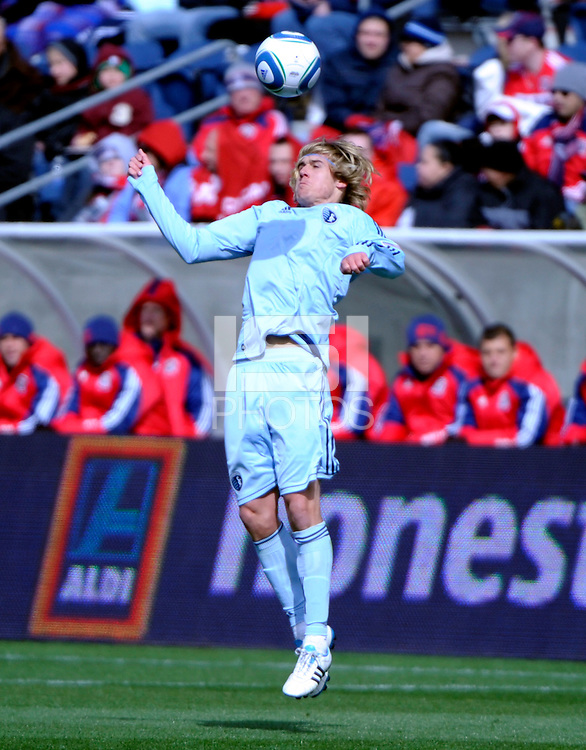 Sporting KC defender Chance Myers (7) goes up for a header.  The Chicago Fire defeated Sporting KC 3-2 at Toyota Park in Bridgeview, IL on March 27, 2011.