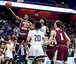 UNCASSVILLE, CT-031818JS12- Sacred Heart's Raheem Solomon says in a shot in front of Notre Dame-Fairfield's Wooley Monnexant (10) and Noreaga Davis (20) during their Division I championship game Sunday at Mohegan Sun Arena. <br /> Jim Shannon Republican-American