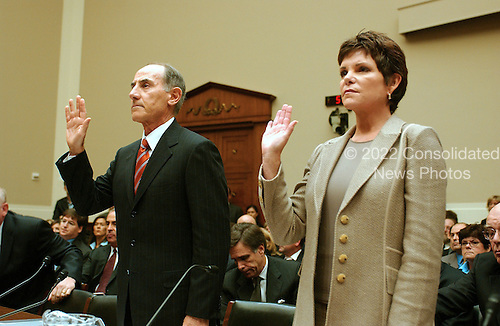 "Washington, D.C. - September 28, 2006 -- Larry Sonsini, Chairman, Wilson Sonsini Goodrich and Rosati, left, and Patricia Dunn, former Chairman of the Board, Hewlett-Packard Company, right, are sworn-in to testify before the United States House Subcommittee on Oversight and Investigations hearing on "" Hewlett-Packard's Pretexting Scandal"" in Washington, D.C. on September 28, 2006..Credit: Ron Sachs / CNP.[No New York Metro or other Newspapers within a 75 mile radius of New York City]"