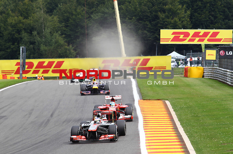 22.08 - 25.08.2013, Circuit de Spa, Francorchamps, BEL, F1, Grosser Preis von Belgien, im Bild  DHL Branding - Jenson Button (GBR),  McLaren F1 Team  - Fernando Alonso (ESP),  Scuderia Ferrari - Mark Webber (AUS), Red Bull Racing <br />  Foto &copy; nph / Mathis