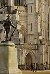 War memorial statue of soldier looking over the front of Winchester Cathedral