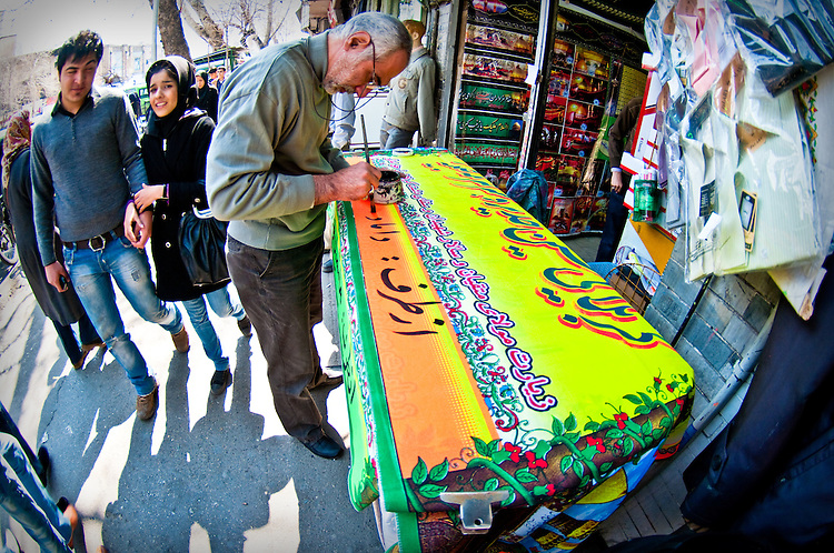 The pilgrimage to Mecca is an important event in the life of muslims. Muslims in iran celebrate their return from a pilgrimage by welcoming family and friends to their home and giving away food to poorer people in the neighbourhood. In order to let people know of their safe return, they hang banners such as this one outside their home.