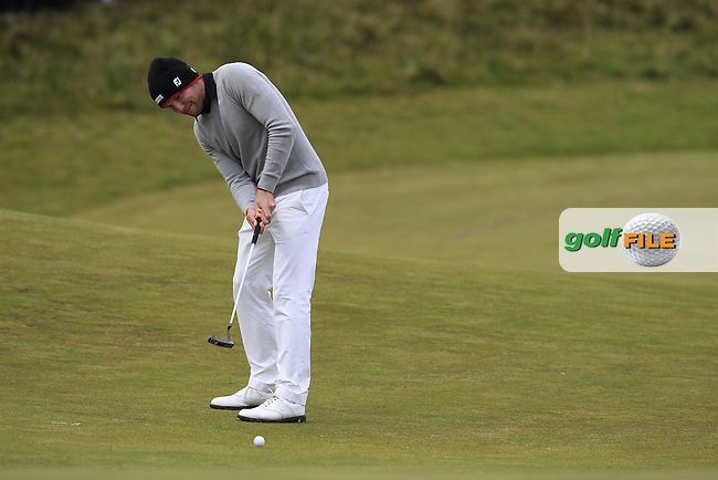 Maximilian KIEFFER (GER) putts onto the 18th green during Saturday's Round 3 of the 2015 Dubai Duty Free Irish Open, Royal County Down Golf Club, Newcastle Co Down, Northern Ireland 5/30/2015<br /> Picture Eoin Clarke, www.golffile.ie
