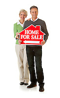 Series with a mature couple, mid 50's, in various themes, including healthy eating, medical and fun.  Isolated on white and an interior room.  Holding a Home For Sale sign.