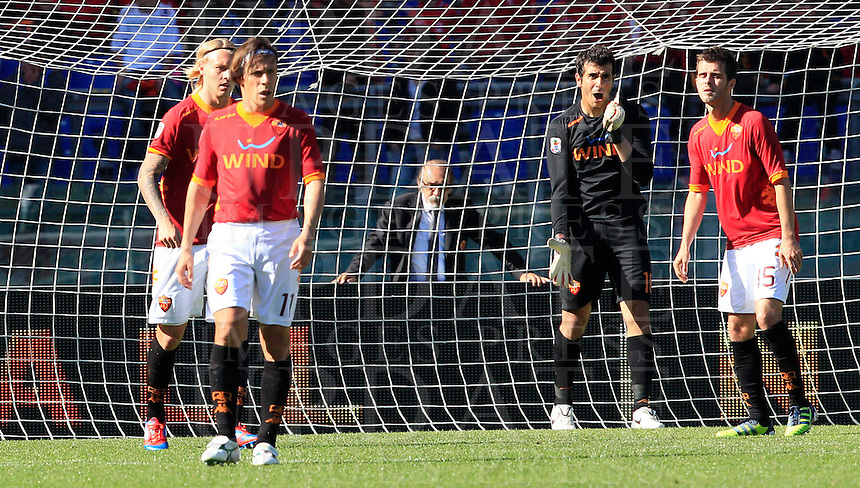 Calcio, Serie A: Roma-Fiorentina. Roma, stadio Olimpico, 25 aprile 2012. Da sinistra, i romanisti Simon Kjaer, Rodrigo Taddei, Gianluca Curci e Miralem Pjanic dopo il gol del 2-1 definitivo segnato dalla Fiorentina..From left, AS Roma's Simon Kjaer, Rodrigo Taddei, Gianluca Curci and Miralem Pjanic react after Fiorentina scored the winning goal during the Italian Serie A football match between AS Roma and Fiorentina, at Rome Olympic stadium, 25 april 2012.  Fiorentina won 2-1..UPDATE IMAGES PRESS/Riccardo De Luca