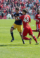 April 27, 2013: New York Red Bulls forward Fabian Espindola #9 and Toronto FC defender Darren O'Dea #48 in action during a game between Toronto FC and the New York Red Bulls at BMO Field  in Toronto, Ontario Canada..The New York Red Bulls won 2-1.