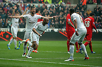 Andre Ayew of Swansea City (C) celebrates his opening goal during the Barclays Premier League match between Swansea City and Liverpool at the Liberty Stadium, Swansea on Sunday May 1st 2016