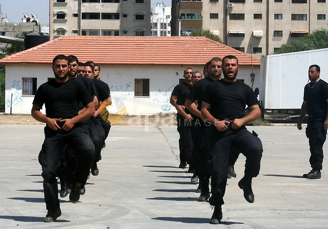 Members of Hamas' security forces demonstrate their skills during a graduation ceremony in Gaza City June 17, 2010. Photo by Ashraf Amra