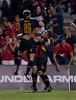 Jake Pace (20) celebrates his goal with teammates Patrick Mullins (15) and Tsubasa Endoh (31) of Maryland during the game at Ludwig Field on the campus of the University of Maryland in College Park, MD.  Maryland defeated Pittsburgh, 2-0.