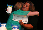 Esmeralda Walters hugs Instructor Specialist Jody Coxon as more than 100 students receive their High School Equivalency during a Western Nevada College ceremony in Carson City, Nev., on Monday, June 19, 2017. <br /> Photo by Cathleen Allison/Nevada Photo Source