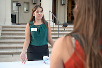 Occidental College student Amanda Morales '16 shares her InternLA experience working at the Mexican American Legal Defense and Educational Fund (MALDEF) during the Career Development Center's Reverse Career Fair, Thorne Hall patio, Sept. 3, 2015.<br /> (Photo by Marc Campos, Occidental College Photographer)
