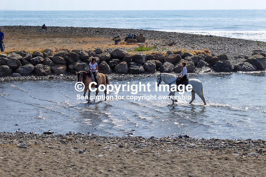 Horses cool the heels in the Mediterranean near Puerto Banus, Spain, when out for a Sunday canter along the Costa del Sol. 23rd April 2017, 201704233482<br /> <br /> Copyright Image from Victor Patterson, 54 Dorchester Park, <br /> Belfast, UK, BT9 6RJ<br /> <br /> t1: +44 28 9066 1296 (from Rep of Ireland 048 9066 1296)<br /> t2: +44 28 9002 2446 (from Rep of Ireland 048 9002 2446)<br /> m: +44 7802 353836<br /> <br /> e1: victorpatterson@me.com<br /> e2: victorpatterson@gmail.com<br /> <br /> www.victorpatterson.com<br /> <br /> Please see my Terms and Conditions of Use at www.victorpatterson.com. It is IMPORTANT that you familiarise yourself with them.<br /> <br /> Images used on the Internet must be visibly watermarked i.e. &copy; Victor Patterson within the body of the image and copyright metadata must not be deleted. Images used on the Internet have a size restriction of 4kbs and will be chargeable at current NUJ rates unless agreed otherwise.<br /> <br /> This image is only available for the use of the download recipient i.e. television station, newspaper, magazine, book publisher, etc, and must not be passed on to any third party. It is also downloaded on condition that each and every usage is notified within 7 days to victorpatterson@me.com<br /> <br /> The right of Victor Patterson to be identified as the author is asserted in accordance with The Copyright Designs And Patents Act (1988).