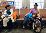 Silvia Penado (left) and Mirna Vasquez, refugees from El Salvador, sit in the airport in San Antonio, Texas, on December 2, 2015. With Vasquez is her daughter Catarin. The women fled their homes with their children to escape gang-related violence. After requesting political asylum in the United States, they were held for several days by immigration officials and then released with ankle monitors. They stayed briefly in a shelter run by the Refugee and Immigrant Center for Education and Legal Services (RAICES) and supported by a coalition of San Antonio churches, then flew to another location in the U.S. while they await final decisions on their asylum petitions.