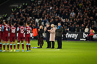 28th December 2019; London Stadium, London, England; English Premier League Football, West Ham United versus Leicester City; The family of Martin Peters alongside Sir Geoff Hurst with a wreath and a minutes applause in memory of the West Ham United, Tottenham Hotspur, Norwich City and 1966 England World Cup winner Martin Peters after his passing on Saturday 21st December 2019 due to Alzheimer's disease - Strictly Editorial Use Only. No use with unauthorized audio, video, data, fixture lists, club/league logos or 'live' services. Online in-match use limited to 120 images, no video emulation. No use in betting, games or single club/league/player publications