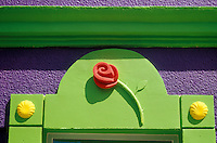 Wooden rose design above the doorway of a boutique in the town of San Jose del Cabo, Baja California Sur, Mexico