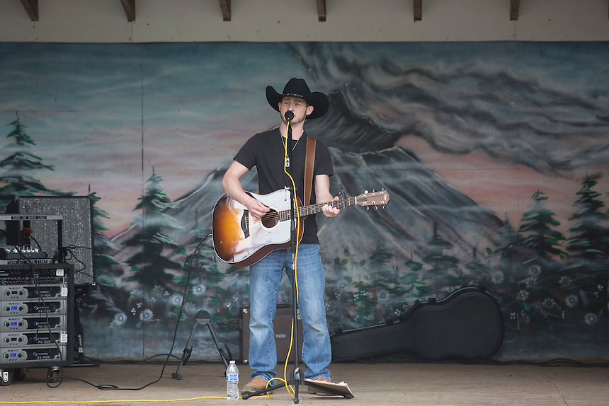 """Local musician Charlie Green plays guitar and sings at the annual """"Territorial Days"""" festival in Amboy Sunday July 10, 2016. Other events during the celebration included a logging show, musical performances, an art show and a carnival. The celebration highlights the area's connection to logging and pioneering. (Photo by Natalie Behring/ for the The Columbian)"""