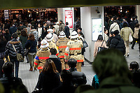 Firefighters in Shinagawa station, Tokyo, 11 March 2011. After a huge earthquake in north-east Japan several million people in Tokyo struggle to return home.