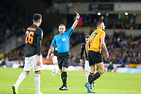 4th January 2020; Molineux Stadium, Wolverhampton, West Midlands, England; English FA Cup Football, Wolverhampton Wanderers versus Manchester United; Referee Paul Tierney gives Romain Saiss of Wolverhampton Wanderers a yellow card after a foul on Tahith Chong of Manchester United  - Strictly Editorial Use Only. No use with unauthorized audio, video, data, fixture lists, club/league logos or 'live' services. Online in-match use limited to 120 images, no video emulation. No use in betting, games or single club/league/player publications