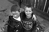 Children in a street in the former pit village of Grimethorpe, South Yorkshire, which has undergone serious decline since its colliery closed in 1993, and where many ex-miners' houses are empty and vandalised.