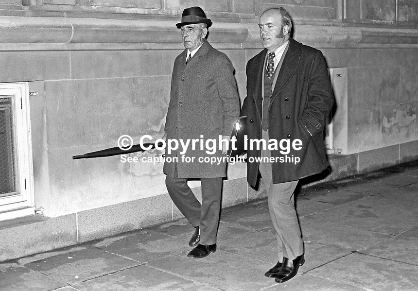 Johnny McQuade, Democratic Unionist assemblyman, left, and James Craig, Vanguard Unionist assemblyman, leaving the Stormont Parliament Building after being involved in fighting during which two Ulster Unionist assemblymen, Herbert Kirk, finance minister, and Peter McLachlan, were injured. McQuade was a former professional boxer who fought under the name, Jack Higgins. 197312050748a.<br />